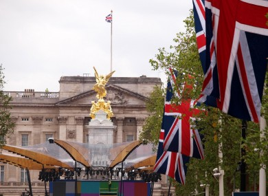 Work continues on the stage in front of the Victoria monument, and Buckingham Palace on the flag bedecked Mall, London, as preparations continue for the Jubilee celebrations.