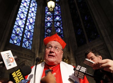 Report author Cardinal Timothy Dolan addressing reporters in New York earlier this year