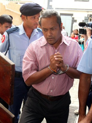 Murder accused Sandip Moonea at the Supreme Court in Port Louis.