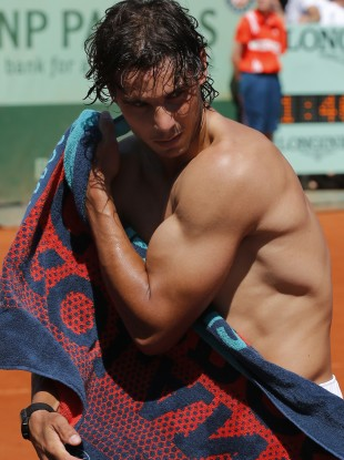 Spain's Rafael Nadal wipes his body after defeating compatriot David Ferrer.