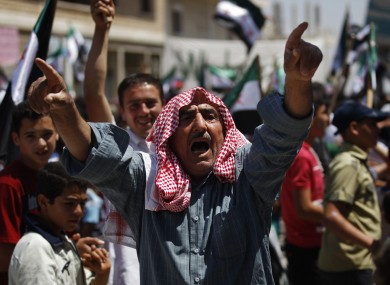 A protester chants slogans at an anti-regime rally in Idlib, northern Syria