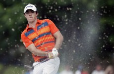 McIlroy shoots 5-under 65 to take lead in Memphis