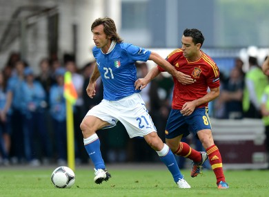 Andrea Pirlo and Spain's Xavi.