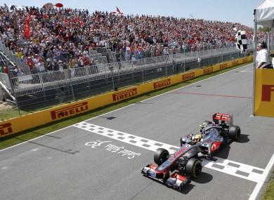 Hamilton crosses the line in Montreal.