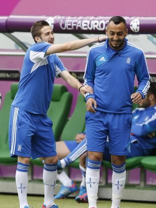 Costas Fortounis, left, and Costas Mitroglou joke during yesterday's training session.