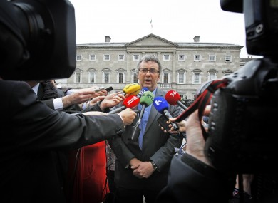 All focus was on the chair of the Committee on Members' Interests, Thomas Pringle, outside the Dáil today as he briefed the media over Mick Wallace.
