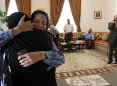 Dr Fatima Haji (second from left) hugs another woman after hearing of the judge's verdict today.