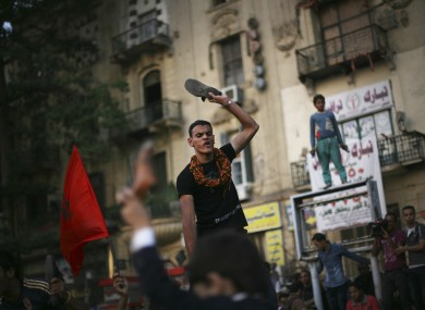 A protester chants slogans against the regime in Tahrir Square, Cairo today.