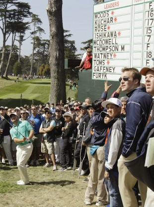 McDowell hits out of the gallery on the eighth hole.