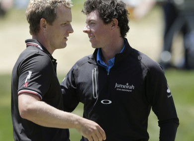 Luke Donald and defending champion Rory McIlroy embrace after their second round efforts.
