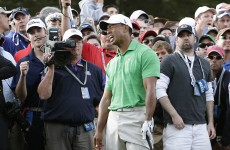 VIDEO: Tiger Woods collides with a cameraman