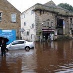 The centre of Hebden Bridge today with the town cinema and streets surrounded by floodwaters. (John Giles/PA Wire)