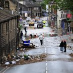 Floodwaters surrounds local shops in the centre of Mytholmroyd near Huddersfield, West Yorkshire. (John Giles/PA Wire/Press Association Images)
