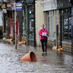 Torrential downpours brought flooding to swathes of northern England, forcing people to leave their homes as more than a month's worth of rain fell in 24 hours. (John Giles/PA Wire)