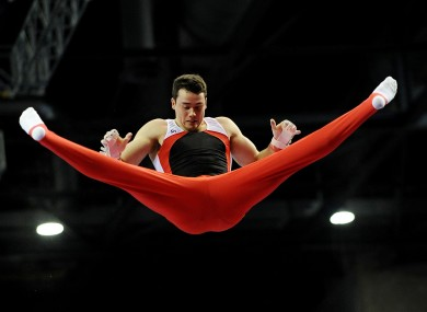 Earls Gymnastics Club's Kristian Thomas performing on the high bar in Liverpool.