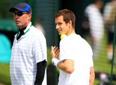 Andy Murray is watched by coach Ivan Lendl.