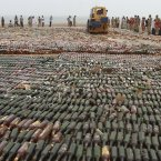 This steam roller crushed bottles of alcohol during a ceremony to mark International Day against Drug Abuse and Illicit Trafficking, on the outskirts of Karachi, Pakistan. (AP Photo/Shakil Adil)