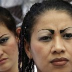 Female inmates attend a religious service marking one hundred days since a peace agreement was reached among gang members at the women's prison of Ilopango in San Salvador, El Salvador. (AP Photo/Luis Romero)