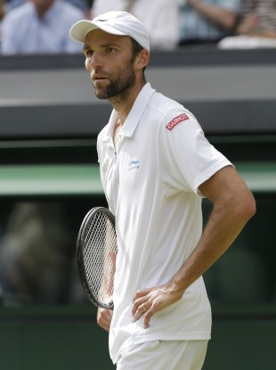 Ivo Karlovic reacts during a second round men's singles match against Andy Murray.