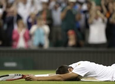 Lukas Rosol eats turf after beating Nadal.