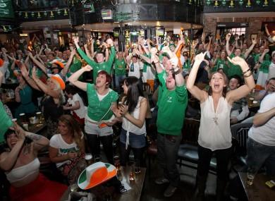 Irish fans celebrate Ireland's goal at the Submarine Bar in Crumlin, Dublin.