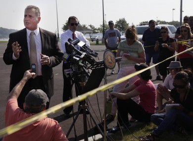 Nassau County Police Department Det. Lt. John Azzata, left, gives information about the fatal boating accident