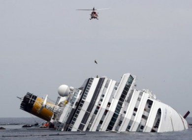File photo: An Italian firefighter is lowered onto the Costa Concordia on 31 January.