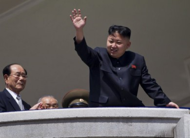 Kim Jong-un waves to supporters after a mass rally in April. Kim has given himself the title of 'Marshal' - an office previously held by his father and grandfather.