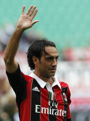 Nesta waves to supporters at the end of a Serie A game with Novara in May.