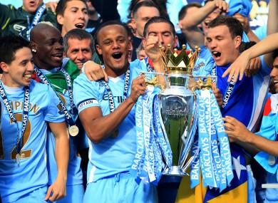 Vincent Kompany lifts the Premier League trophy.
