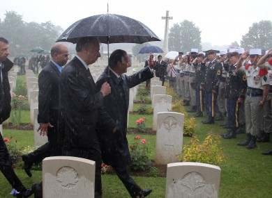 Hollande waves to soldiers at yesterday's ceremony