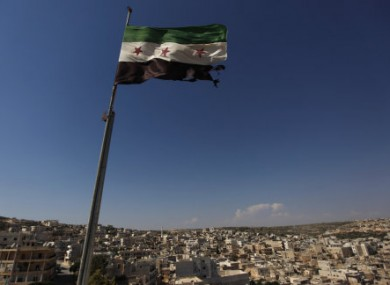 File photo of a Syrian revolutionary flag flying over Aleppo.