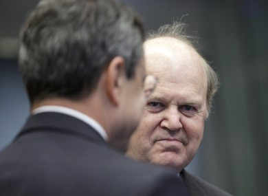 Michael Noonan speaks with Mario Draghi at a meeting in Luxembourg last month
