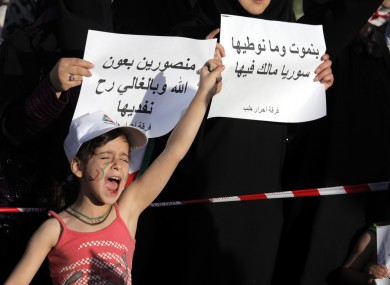 A Syrian girl chants anti-Bashar Assad slogans, during a protest in front the Syrian embassy in Amman, Jordan