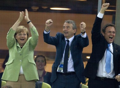Angela Merkel, left, German Soccer Federation President Wolfgang Niersbach and German Interior Minister Hans-Peter Friedrich, right.