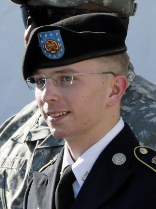 Bradley Manning, seen here leaving court last month, is charged with aiding 'The Enemy' by helping to distribute classified US diplomatic cables.