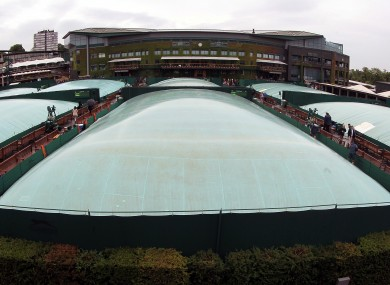 General view of Covers on the outside courts as rain falls on Day Seven of the 2012 Wimbledon Championships.