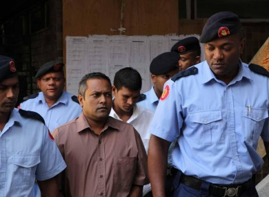 The two accused men arriving at court today accompanied by officers