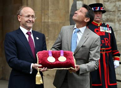 Lord Sebastian Coe, right, greets Jan du Pelessi, chairman of Rio Tinto, the official metal supplier of the London 2012 games, for storage in the vaults at the Tower.