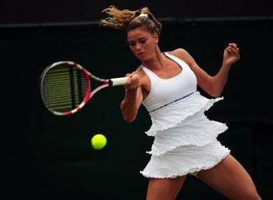 Italy's Camila Giorgi in action against Poland's Agnieszka Radwanska.