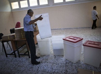 A worker prepares a polling station in Tripoli, Libya yesterday.