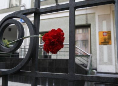 A flower is placed in memory of victims of the flood in Krasnodar region outside the office of the Representation of Krasnodar region in Moscow, Russia