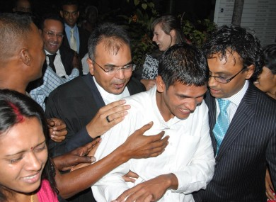 Avinash Treebhoowon, wearing the white shirt, outside the Supreme Court in Mauritius after he was acquitted of murder