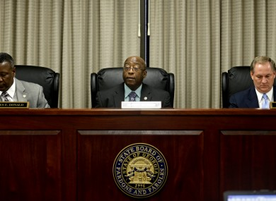 Members of the Georgia Board of Pardons and Paroles, from left, James Donald, Albert Murray, and James Mills,