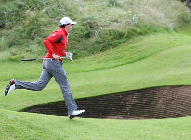 On the run: Rory McIlroy sprints across the green during day two.