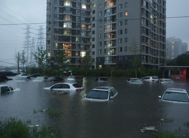 Vehicles submerged at a flooded residence community in Beijing at the weekend
