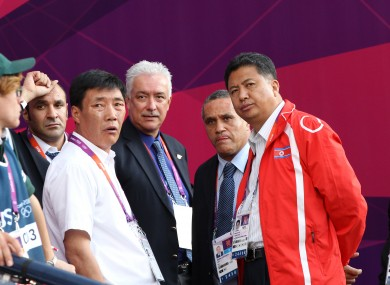 North Korean official Son Kwang Ho (second from the right) speaks to other officials during the delay.