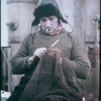 The Bosun John Vincent of the Endurance mending a net in 1915. (Image: Frank Hurley)