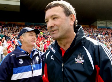 Waterford manager Michael Ryan and Cork counterpart Jimmy Barry-Murphy at the final whistle.