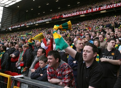 Manchester United fans wave green-and-gold scarves - the club's colours when it was first founded - in protest at the Glazer family's ownership of the club.
